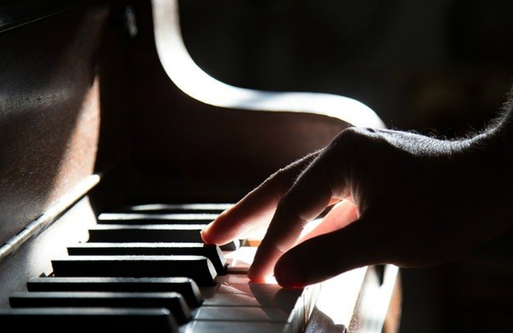 Keeping the webbing intact in fingers would always affect making motions like playing the piano just like leaving the tongue tie intact will always affect proper tongue motion.